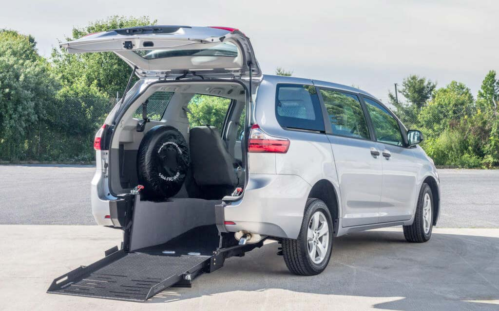 "How to Choose the Best Wheelchair Van for You Wheelchair users can get around with the help of a wheelchair accessible van. Whether the user intends to drive the van or act as a passenger, there are many options available. When comparing wheelchair accessible vans, consider pricing, customer service, vehicle features, warranties and availability. When buying a wheelchair van, make sure to consider whether you prefer a side entry or rear entry option. Ask the company you're considering buying from if they have any available discounts. Last of all, make sure to test drive the wheelchair van to confirm it's a good fit for you. The best wheelchair van companies will be happy to let you take one of their models for a spin. Entry configurations There are two types of entry configurations: side-entry and rear-entry. The entry location impacts wheelchair seating positions, parking options, the ability to accommodate other passengers, and storage availability. Side entry Advantages of a side-entry configuration include: ability to drive from a wheelchair or sit in the front passenger position in a wheelchair or driver position; enter and exit curbside away from traffic; and more storage space. Disadvantages of this style are that it requires a handicap parking space or extra room for ramp deployment and that some driveways are not wide enough to accommodate the vehicle. Side entry vehicles can accommodate 5 passengers at most. Rear entry A rear-entry configuration can be used for attended applications in which the wheelchair occupant is not driving the vehicle but rather riding as a passenger. Rear entry vehicles are simpler, much less costly, require virtually no extra maintenance. Ride and drive quality are very similar to an unconverted vehicle. They will fit into any garage. Other advantages of a rear-entry vehicle are that, with the exception of parallel parking, no extra room is required for a ramp, and the side passenger doors aren't blocked. In addition, mid-passenger seats can be mounted next to the wheelchair position. Other advantages include more ground clearance and more room for long wheelchairs and/or leg rests. One manufacturer (FR Conversions) makes a 48"" wide RE ramp. The widest in the industry which can handle virtually any wheelchair. Rear entry vehicles are often converted from good used vehicles into a ""Used / New"" configuration which is much more affordable and places a wheelchair accessible vehicle within reach of many in need who otherwise could not afford one. It is a great 'starter"" vehicle for consumers who are unsure of which configuration would work best and is a good entry point from a wheelchair carrier to one where transferring is no longer necessary. Limitations of the rear-entry style are the requirement to enter and exit from a traffic area although no special parking space is required. The inability to drive from the wheelchair and/or have the wheelchair in the front passenger position and less storage space are disadvantages. Rear entry vehicles are available in two configurations. Long cut and short or taxi cut. The long cut handles two wheelchairs the short cut one. Types of access Ramp Ramp based modifications are most commonly performed on minivans. In order to provide access for the wheelchair user, the floor on side-entry vehicles is lowered 8–12 in (203–305 mm). In rear-entry configuration, the floor is not lowered but rather removed, and a composite or steel tub is inserted. Ramps come in two styles—fold-up or in-floor—and two operating modes—manual or motorized. Fold-up ramps fold in half and stow upright next to the side passenger door in a side-entry configuration or inside the rear access doors in a rear-entry configuration. Fold-up ramps present a lower ramp angle than in-floor ramps; however, in side-entry configurations, they are in the way of the passenger entrance when stowed. In-floor ramps slide into a pocket underneath the vehicle's floor and are only available for side-entry configurations. Folding ramps are available in manual or motorized versions for both entry configurations. Older style applications may also have a ""kneeling feature"" that reduces the angle of the ramp by compressing the suspension of the van on the ramp side, newer ones using complex geometry eliminate the need for kneeling to meet ADA standards although they may employ a retracting system as an option, that eliminates the stress of compressing the suspension. Some other advantages of the fold-out ramp for the side entry vehicle are that an unaccompanied wheelchair driver can ""Self-Rescue"" in the event of a system failure and not become trapped in the vehicle; ramp deployment onto a sidewalk or over a curb is sometimes only possible with a fold-out ramp because it will deploy out and over the curb; in very snowy climates the ramp remains inside the vehicle, away from the weather. A secondary disadvantage of the side entry fold-out ramp is that they rattle inside the vehicle. The primary advantages of the in-floor ramp configuration are that ambulatory passengers have access to the vehicle from the curb side of the vehicle; and the ramp is stowed under the floor. The possible disadvantages are that the ramp is not able to overcome or deploy onto higher curbs, snow and ice may be retained in the ramp""tray""; not all models are ADA compliant because of the ramp's side edge height; self-rescue may not be possible. Minivans that are most frequently converted: Dodge Grand Caravan & Chrysler Town & Country new production of these will end on early 2020. The Dodge Grand Caravan was the most common converted vehicle because of cost and length of the production run, the success, of the chassis. They will continue to be converted in the ""Used / New"" space for years to come. Chrysler Pacifica, replacing the Town and Country and the more popularly priced Voyager (2020) are currently available and expected to replace the volume and position of the Grand Caravan in the wheelchair accessible conversion space. Toyota Sienna is the second most converted chassis. It is due for some major updates in subsequent model years but is expected to retain its position in the market with several conversion configurations. Honda Odyssey, a distant 3rd in market share in the market, is available from several converters in a side entry, in floor configuration and considered by some to be the most ""upscale"" of the chassis adapted for wheelchair use. Platform lifts Full size vans require lifts in the form of a platform that can be raised and lowered from inside the vehicle down to the ground outside. They have a bigger platform and higher load capacity so they are suitable even for heavy electric wheelchairs with a heavy occupant (more than 600lbs in all). If you'd like to drive a wheelchair conversion van, truck or car, you may need to see a Certified Driver for evaluation. Your consultation will result in a prescription that lists the precise equipment you will need and may result in driving lessons with the new equipment. A new wheelchair van can cost anywhere from $40,000 to $100,000. Wheelchair van prices can be broken down into the price of the van itself and the cost of additional modifications. The cost of a van can ranges from $20,000 all the way up to $70,000. The cost of handicap van modifications ranges from $15,000 to $30,000. This might seem like a lot, but these modifications require highly skilled, careful engineering. Grants are available to help offset wheelchair van costs. Availability varies by state, as does the amount offered. Certain charitable organizations can also help, as can Veterans Affairs programs. Will Medicare pay for a wheelchair van? No Will Medicaid pay for a wheelchair van? It depends on the state. Most states do not. Nebraska does not. Is a wheelchair van tax deductible? Yes, the conversion portion of the wheelchair van It's important to purchase your wheelchair van from a long-time trusted business such as Kohll's Rx. The company should be able to assist with financing and trade-ins. The company also shouldn't be too pushy with you because it's not as simple as purchasing a regular vehicle. The wheelchair must fit you and work with your disability. You and your family will continue or begin to have independence if you chose the right wheelchair van with the assistance of a reputable wheelchair van company such as Wheelchair Vans of Kohll's!"