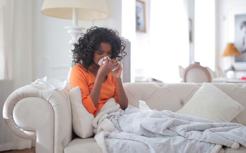 Woman feeling ill.
